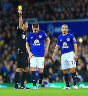 Referee Mark Clattenburg shows James McCarthy of Everton a yellow card - Everton vs. West Ham United - Barclay's Premier League - Goodison Park - Liverpool - 22/11/2014 Pic Philip Oldham/Sportimage