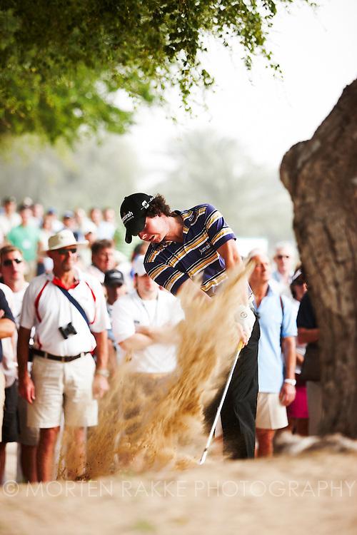 Dubai Desert Classic, 2010. Rory McIlroy, IRE, hits from the sand. Photo by Morten RakkePhoto by Morten Rakke