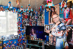 Shaun Smith, 52, from Basildon in Essex shows off his favourite Cheryl Cole picture, mounted in a silver frame. At a cost of around £7,000 he has built up a huge collection of Cheryl Cole memorabilia in the space of about eight months after she impressed him in a music video he was watching.. PLACE, January 24 2019.