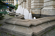 A fountain outside the The Romanian Athenaeum concert hall in the center of Bucharest, Romania
