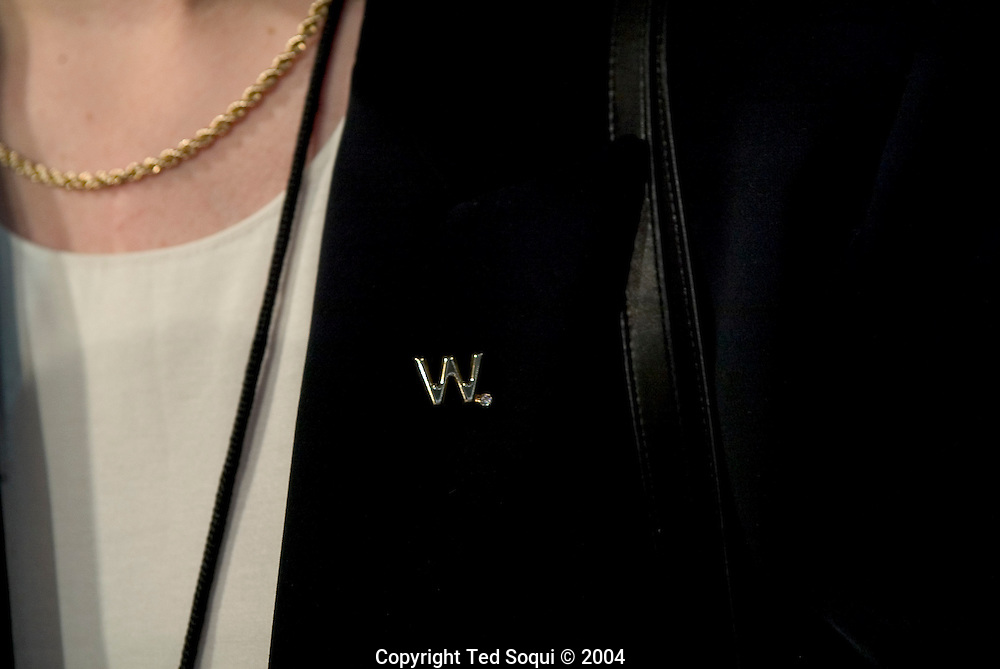 "A woman delegate wearing a solid gold ""W"" pin with a diamond attached to it on the floor of the RNC..RNC, Madison Square Garden, NYC, NY USA.9/1/04."