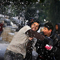 Palestinian youth having a snow ball fight in a park overlooking Jerusalem's old city under snow, January 31, 2008. Photo by Michal Fattal/Flash90,