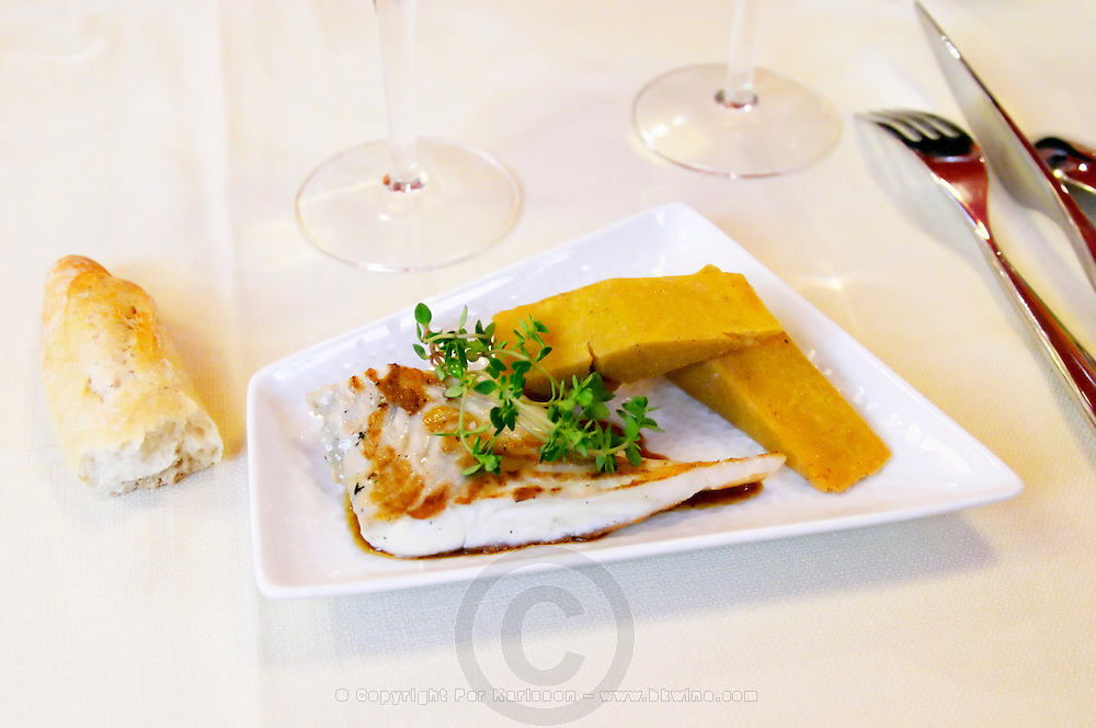 Grilled turbot with parsnip cake and thyme, a broken bread on the table, the restaurant Blanc Le Bistrot in Toulon, very design art-deco Toulon Var Cote d'Azur France