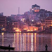 Manikarnika, the main burning ghat of Varanasi seen from the opposite shore of the Ganges