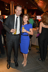 ANDREA CATHERWOOD and GRAY SMITH at the 2014 Costa Book of The Year Awards held at Quaglino's, Bury Street, London on 27th January 2015.  The winner of the Book of The Year was Helen Macdonald for her book H is for Hawk.
