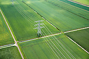 Nederland, Groningen, Nieuwe Pekela, 27-08-2013; hoogspanningsmast en hoogspanningsleiding in de polder Pekela-Zuidkant. Akkers vol aardappels in rechte percelen verdeeld door sloten voor de afwatering.<br /> Power pylon and power transmission lines in the polder. Potato production in the field.<br /> luchtfoto (toeslag op standaard tarieven);<br /> aerial photo (additional fee required);<br /> copyright foto/photo Siebe Swart.