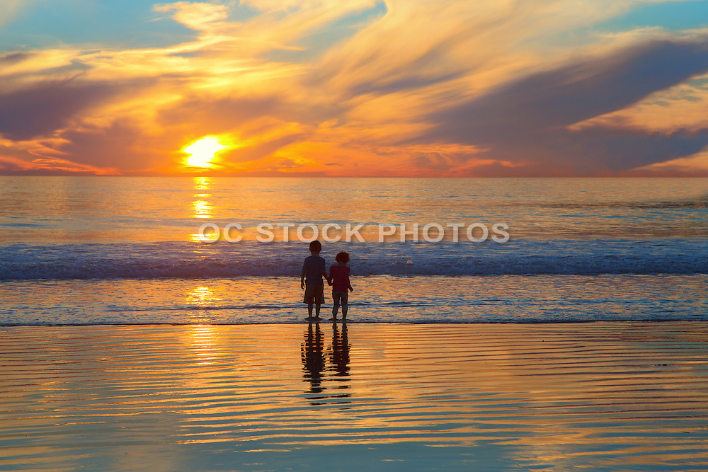 Young Kids Standing at the Shore at Sunset in San Clemente