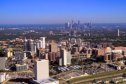 Stock photo of an aerial view of the Texas Medical Center with the downtown skyline beyond.