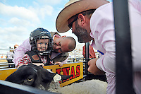 """Colton Brown, 4, gets some parental advice before his mutton bustin' run at Thursday's """"Tough Enough To Wear Pink"""" night at the 2014 California Rodeo Salinas."""