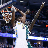 03 February 2016: Denver Nuggets forward Kenneth Faried (35) is fouled going for the reverse dunk on Milwaukee Bucks forward Thon Maker (7) during the Denver Nuggets 121-117 victory over the Milwaukee Bucks, at the Pepsi Center, Denver, Colorado, USA.