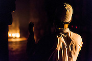 """20th August 2015, New Delhi, India.  A  Muslim man stands before a shrine devoted to Djinns in the ruins of Feroz Shah Kotla in New Delhi, India on the 20th August  2015<br /> <br /> PHOTOGRAPH BY AND COPYRIGHT OF SIMON DE TREY-WHITE a photographer in delhi<br /> + 91 98103 99809. Email: simon@simondetreywhite.com<br /> <br /> People have been coming to Firoz Shah Kotla to pray to and leave written notes and offerings for Djinns in the hopes of getting wishes granted since the late 1970's. Jinn, jann or djinn are supernatural creatures in Islamic mythology as well as pre-Islamic Arabian mythology. They are mentioned frequently in the Quran  and other Islamic texts and inhabit an unseen world called Djinnestan. In Islamic theology jinn are said to be creatures with free will, made from smokeless fire by Allah as humans were made of clay, among other things. According to the Quran, jinn have free will, and Iblīs abused this freedom in front of Allah by refusing to bow to Adam when Allah ordered angels and jinn to do so. For disobeying Allah, Iblīs was expelled from Paradise and called """"Shayṭān"""" (Satan).They are usually invisible to humans, but humans do appear clearly to jinn, as they can possess them. Like humans, jinn will also be judged on the Day of Judgment and will be sent to Paradise or Hell according to their deeds. Feroz Shah Tughlaq (r. 1351–88), the Sultan of Delhi, established the fortified city of Ferozabad in 1354, as the new capital of the Delhi Sultanate, and included in it the site of the present Feroz Shah Kotla. Kotla literally means fortress or citadel."""