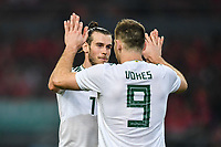 Gareth Bale, left, of Wales national football team celebrates with his teammate Sam Vokes after scoring against Chinese national men's football team in the semi-final match during the 2018 Gree China Cup International Football Championship in Nanning city, south China's Guangxi Zhuang Autonomous Region, 22 March 2018.
