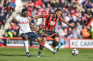 Tottenham Hotspur Midfielder, Victor Wanyama (12) tackles AFC Bournemouth Forward, Callum Wilson (13) during the Premier League match between Bournemouth and Tottenham Hotspur at the Vitality Stadium, Bournemouth, England on 22 October 2016. Photo by Adam Rivers.