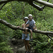 Mother and son hike on island of Maui.