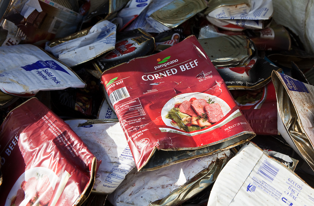 Crushed corned beef tins ready for recycling in the prison. HMP Guys Marsh is a category C prison in Dorset housing 578 prisoners.