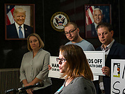 """31 OCTOBER 2019 - DES MOINES, IOWA: EMILY HOLLEY, Executive Director of Iowa Voices, speaks out against a recent healthcare vote in the US Senate during a protest at the Neil Smith Federal Building in Des Moines. A small crowd of people came to the federal building, where US Senators Chuck Grassley's (R-IA) and Joni Ernst's (R-IA) offices are, to deliver a petition protesting the Senate's vote that critics say would allow """"spooky junk health insurance plans"""" with limited coverage and would allow insurance companies to deny coverage to people with pre-existing conditions.           PHOTO BY JACK KURTZ"""