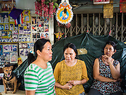 21 SEPTEMBER 2015 - BANGKOK, THAILAND:  Women who live near Wat Kalayanamit talk after being updated on the status of evictions going on near the temple. Fiftyfour homes around Wat Kalayanamit, a historic Buddhist temple on the Chao Phraya River in the Thonburi section of Bangkok are being razed and the residents evicted to make way for new development at the temple. The abbot of the temple said he was evicting the residents, who have lived on the temple grounds for generations, because their homes are unsafe and because he wants to improve the temple grounds. The evictions are a part of a Bangkok trend, especially along the Chao Phraya River and BTS light rail lines. Low income people are being evicted from their long time homes to make way for urban renewal.   PHOTO BY JACK KURTZ