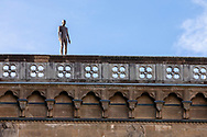 An Anthony Gormley statue on the Ufizzi Gallery in Florence, Tuscany, Italy.<br /> Picture date: Sunday February 24, 2019.<br /> Photograph by Christopher Ison ©<br /> 07544044177<br /> chris@christopherison.com<br /> www.christopherison.com
