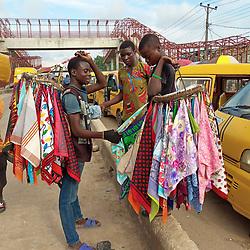 June 10, 2019 - Lagos, Nigeria - Boys selling handkerchiefs discuss at Iyana-Ipaja, Lagos, Nigeria on Monday June, 10, 2019. Street trading, despite the fact that is against the law, is a means of survival in Lagos. Photo by Adekunle Ajayi  (Credit Image: © Adekunle Ajayi/NurPhoto via ZUMA Press)