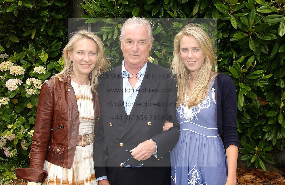 """LORD & LADY BELL with their daughter the HON.DAISY BELL at the Goodwood Festival of Speed on 9th July 2006.  Cartier sponsored the """"Style Et Luxe' for vintage cars on the final day of this annual event at Goodwood House, West Sussex and hosted a lunch.<br /><br />NON EXCLUSIVE - WORLD RIGHTS"""