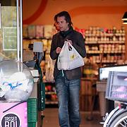NLD/Amsterdam/20130423 - Cabartier Hans Teeuwen doet zijn boodschappen,