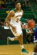 WACO, TX - DECEMBER 18: Ish Wainright #24 of the Baylor Bears brings the ball up court against the Northwestern State Demons on December 18 at the Ferrell Center in Waco, Texas.  (Photo by Cooper Neill/Getty Images) *** Local Caption *** Ish Wainright