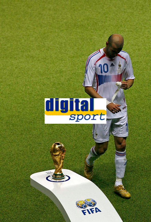 Photo: Glyn Thomas.<br />Italy v France. FIFA World Cup 2006 Final. 09/07/2006.<br /> France's Zinedine Zidane walks past the World Cup after being sent off.
