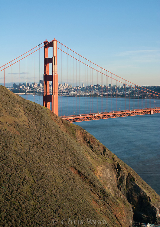 Golden Gate Bridge and cityscape behind headlands, late afternoon, San Francisco, California