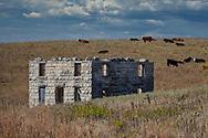 An old stone farm house in the Tall Grass Prairie, in the Flint Hills of Kansas.