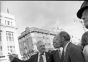 Jim Larkin Statue. O'Connell Street Dublin.   (M77)..1979..15.06.1979..06.15.1979..15th June 1979..Today saw the unveiling of a statue in memory of James (Big Jim) Larkin. Larkin was a trade union activist who was a thorn in the side of many employers who refused to allow workers join unions. A dispute with The Dublin United Tramway Company  escalated into what is now known as the great lock out. Employers banded together and wanted workers to sign a pledge stating that they would not join Larkin's union the Irish Transport And General workers Union (ITGWU). The lock out lasted seven months. During this time Larkin was nited for his rhetoric in standing up for the poor and oppressed within Irish Society...Jim Larkin: Born Jan 21 1876 .Died Jan 30 1947...Pictured in conversation at the unveiling were President Hillery and Denis Larkin, unfortunately we do not the name of the gentleman in the centre.