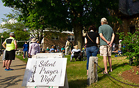 Mayor Andrew Hosmer (far left in photo) joins the Silent Prayer Vigil at the Laconia Congregational Church Friday evening.  (Karen Bobotas/for the Laconia Daily Sun)