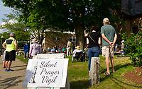 Mayor Andrew Hosmer (far left in photo) joins the Silent Prayer Vigil at the Laconia Congregational Church Friday evening.  (Karen Bobotas/for the Laconia Daily Sun)