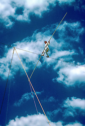 Philip Pettit walking a tight rope outdoors