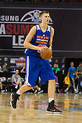 Kristaps Porzingis #46 of the New York Knicks shoots a three-pointer against the San Antonio Spurs during an NBA Summer League game in Las Vegas, Nevada on July 11, 2015. (Cooper Neill for The New York Times)