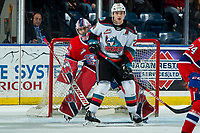 KELOWNA, BC - JANUARY 31: Lukáš Pařík #33 of the Spokane Chiefs watches the puck from behind Matthew Wedman #20 of the Kelowna Rockets at Prospera Place on January 31, 2020 in Kelowna, Canada. Pařík was selected in the third round of the 2019 NHL entry draft by the Los Angeles Kings. Wedman was selected in the 2019 NHL entry draft by the Florida Panthers. (Photo by Marissa Baecker/Shoot the Breeze)
