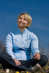 Girl sitting on the grass in nature, on March 17, 2009. (Photo by Vid Ponikvar / Sportida)