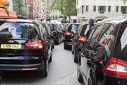 """Mayfair, London, May 24th 2016. Drivers from minicab operator Addison Lee bring traffic to a standstill in Berkely Square, outside of the offices of owner Carlyle Group, in protest against new """"unfair"""" pay rates as the company battles to compete with cut-price Uber, with some drivers claiming they are earning as little as £4.99 per hour. PICTURED: Addison Lee cars clog Berkeley Square."""