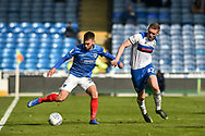 Portsmouth Midfielder, Ben Close (33) holds off Rochdale Midfielder, Ethan Hamilton (27) during the EFL Sky Bet League 1 match between Portsmouth and Rochdale at Fratton Park, Portsmouth, England on 13 April 2019.