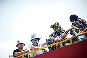 Chinese tourists stand on a bus wearing scarves and hats to protect themselves from the sun of the Gobi Desert in Inner Mongolia, China, July 27, 2014. <br /> <br /> Pale skin has historically been prized as beautiful in China, and the concept is widespread in other Asian countries. Besides health topics, beauty is one of the main reasons that makes protection from the sun's rays so important. <br /> <br /> © Giorgio Perottino