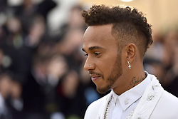 Lewis Hamilton walking the red carpet at The Metropolitan Museum of Art Costume Institute Benefit celebrating the opening of Heavenly Bodies : Fashion and the Catholic Imagination held at The Metropolitan Museum of Art  in New York, NY, on May 7, 2018. (Photo by Anthony Behar/Sipa USA)