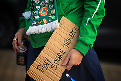 9 October 2017 -  2018 FIFA World Cup Qualifying (Group D) - Wales v Republic of Ireland - A Republic of Ireland fans carries a sign asking for spare tickets and a can of lager - Photo: Marc Atkins/Offside