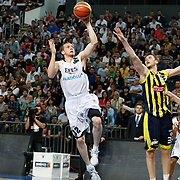 Efes Pilsen's Sinan GULER (L) and Fenerbahce's Marko TOMAS (C) during their Turkish Basketball Legague Play-Off semi final second match Efes Pilsen between Fenerbahce at the Sinan Erdem Arena in Istanbul Turkey on Friday 27 May 2011. Photo by TURKPIX