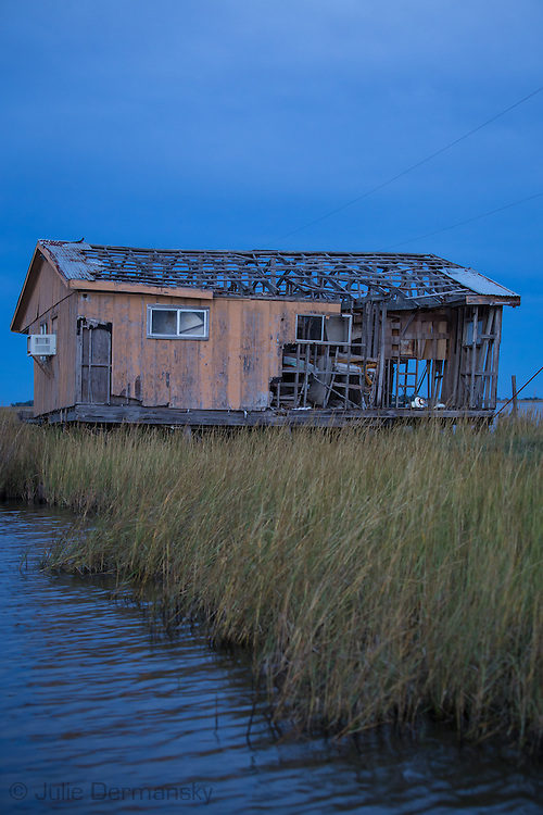 Blighted fishing camp in Point au Chien, Louisiana. Point au Chien is subject to coastal erosion. The area is inhabited by members of the Point-aux-Chien indian tribe and fishermen.