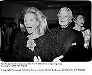 Marylin Lewis & Harry Lewis  at the Beverly Hills Hotel re-Opening Party. Los Angeles. 1995. Film 95264/8<br /><br />© Copyright Photograph by Dafydd Jones<br />66 Stockwell Park Rd. London SW9 0DA<br />Tel 0171 733 0108