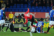 Cardiff city's Leon Barnett © is denied by Barnsley keeper Luke Steele and Chris O'Grady ®. Npower championship, Cardiff city v Barnsley at the Cardiff city stadium in Cardiff, South Wales on Tuesday 9th April 2013. pic by Andrew Orchard,  Andrew Orchard sports photography,