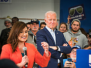 04 JANUARY 2020 - DES MOINES, IOWA: Former Vice President JOE BIDEN, right, listens to Congresswoman ABBY FINKENAUER (D-IA) introduce him at a campaign event in Des Moines. Vice President Biden is touring Iowa this week to support his candidacy for the US Presidency. Iowa hosts the first presidential selection event of the 2020 election cycle. The Iowa caucuses are on February 3, 2020.            PHOTO BY JACK KURTZ