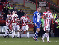 Photo. Glyn Thomas.<br /> Sheffield United v Colchester. FA Cup fifth round.<br /> Bramall Lane, Sheffield. 15/02/2004.<br /> Sheffield's Paul Peschisolido is congratulated by teammates after scoring his side's winning goal.