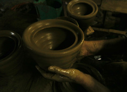 May 9, 2017 - Gaza City, The Gaza Strip, Palestine - A Palestinian worker uses a pottery wheel to construct pots, at pottery workshop in Gaza City. (Credit Image: © Mahmoud Issa/Quds Net News via ZUMA Wire)