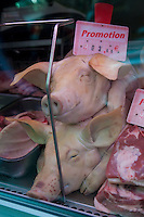 Pig heads on sale in a Paris butcher