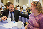 Aidan Burley MP in discussion with his constituent Clara Lewis at the Tea time for change event. Refreshing the call for justice. Organised by the UK's leading NGO's.  Enabling constituents to dicuss the subject with their MP.